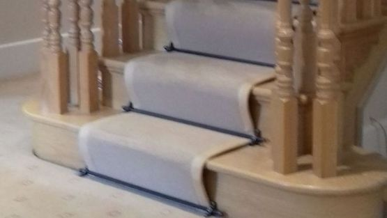 A carpet installed on some stairs